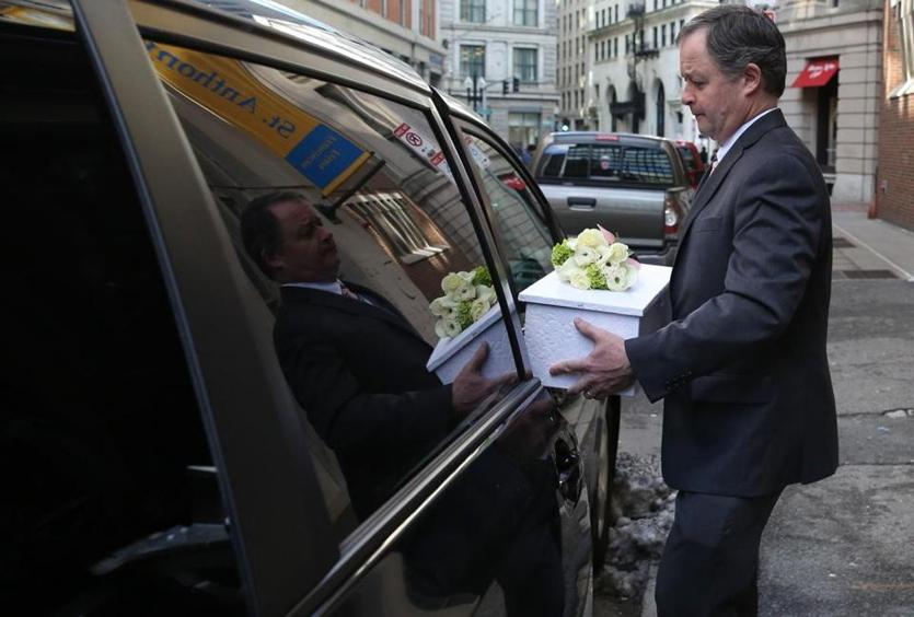 Funeral Director Jed Dolan carried Angela's casket to his car after the funeral.